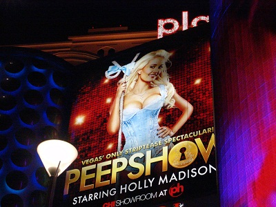 sign showing holly madison in reveling top