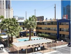 travel lodge swimming pool and courtyard scene of many parties