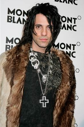 criss angel looking pimp in his fur coat