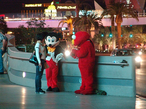 mickey and elmo in front of planet hollywood