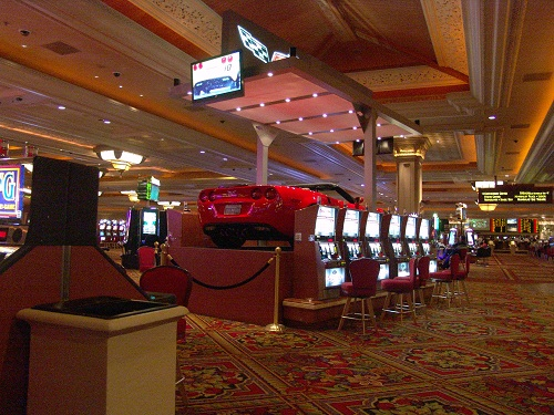 red corvette on top of slot machines