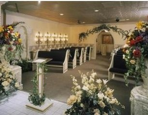 wedding chapel showing alter and pews