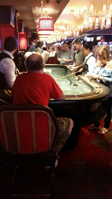 You can sit in a chair and play at the traditional Craps Table