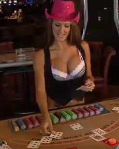 beautiful girl with big fake breast dealing cards